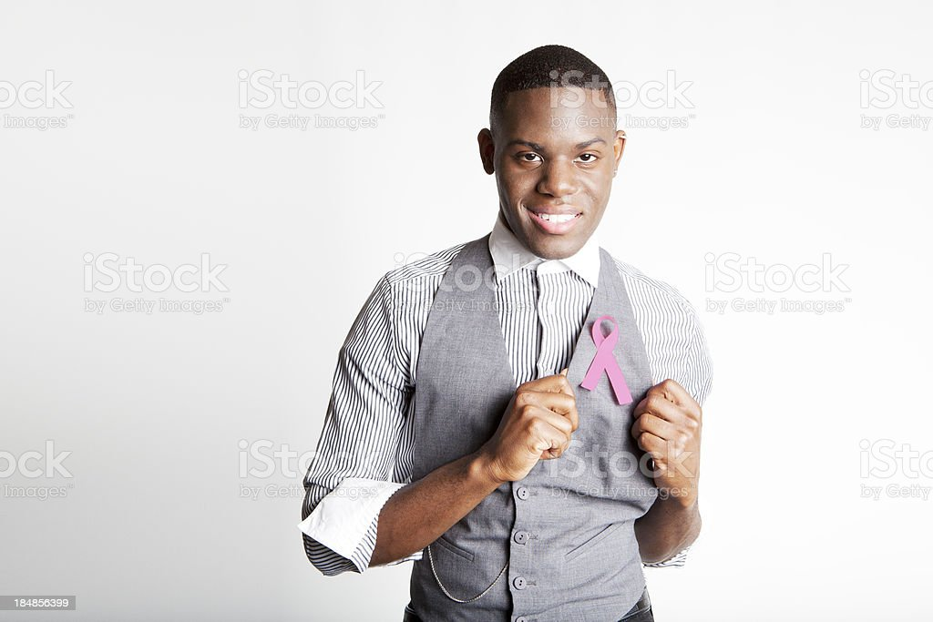 Smiling Man Supporting Breast Cancer with Pink Ribbon stock photo