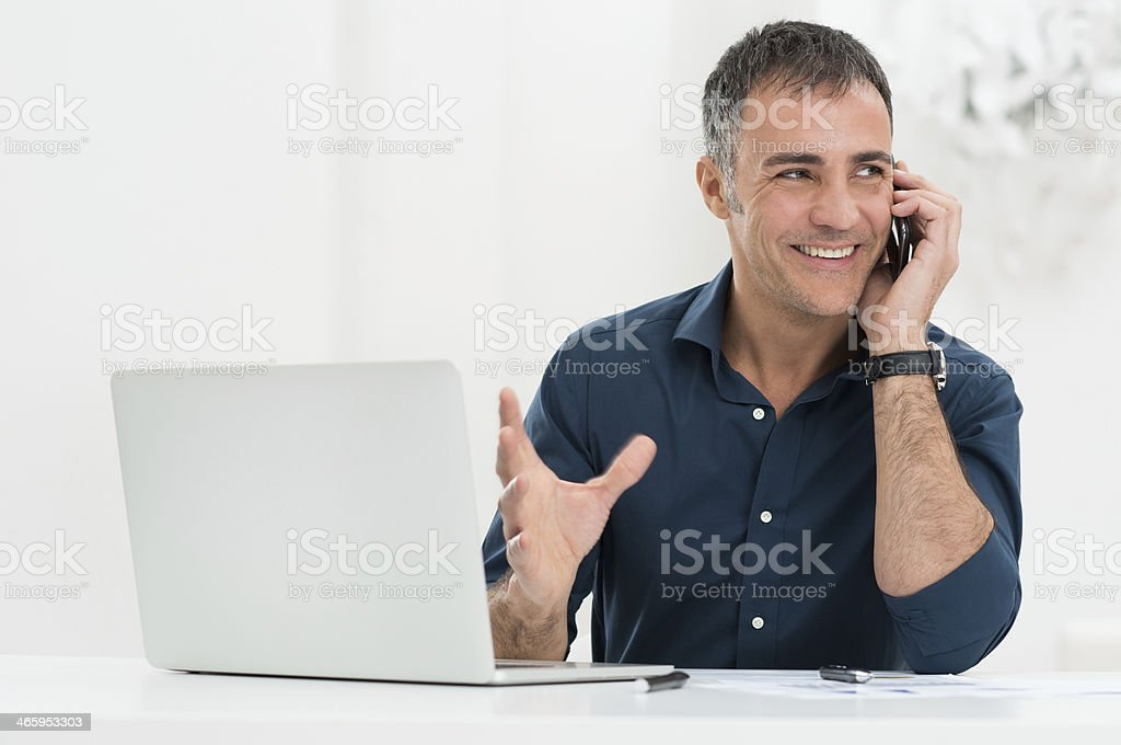 Smiling Man Talking On Cellphone stock photo