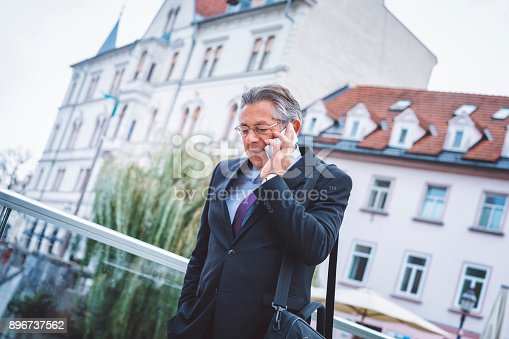 istock Smiling man talking on cellphone 896737562