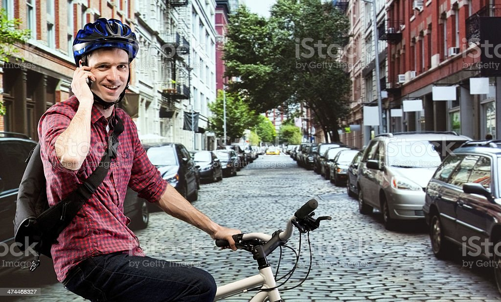 Smiling man talking on mobile with bicycle royalty-free stock photo