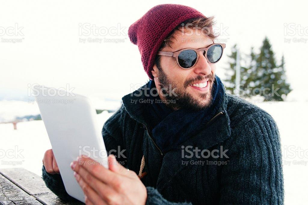 Smiling man using digital tablet. stock photo