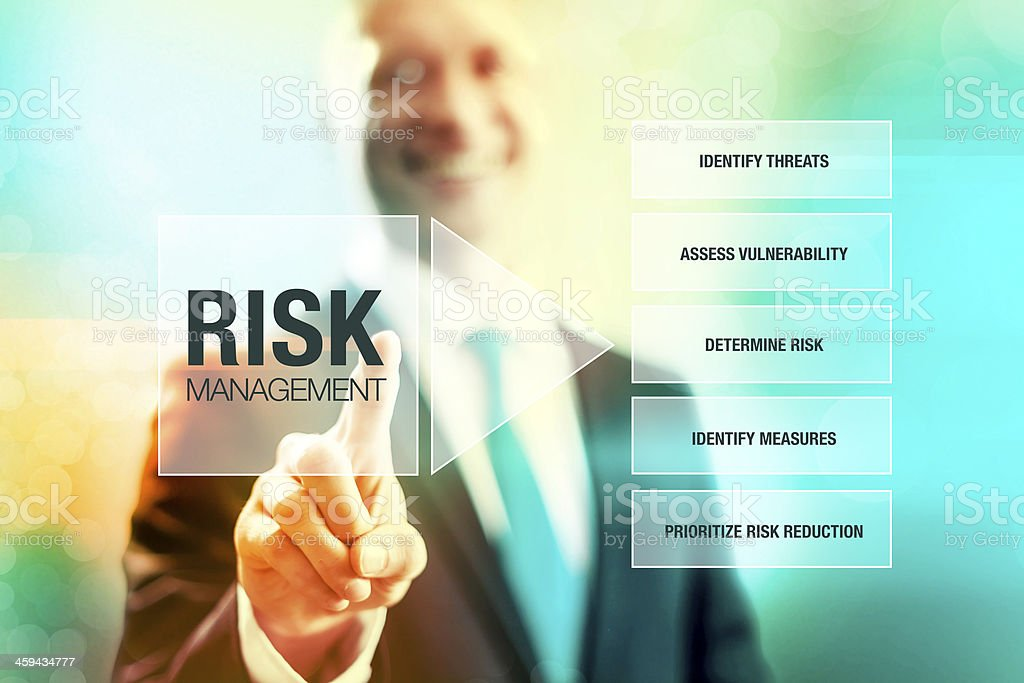 Smiling man using risk management interface stock photo
