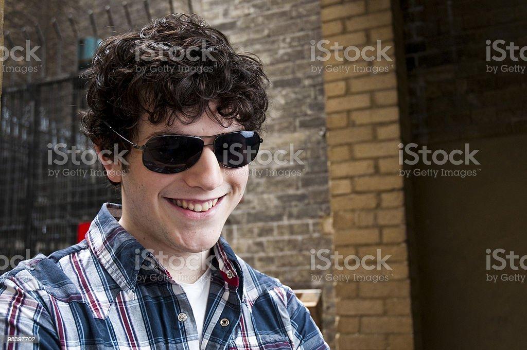 Smiling man wearing sun glasses royalty-free stock photo