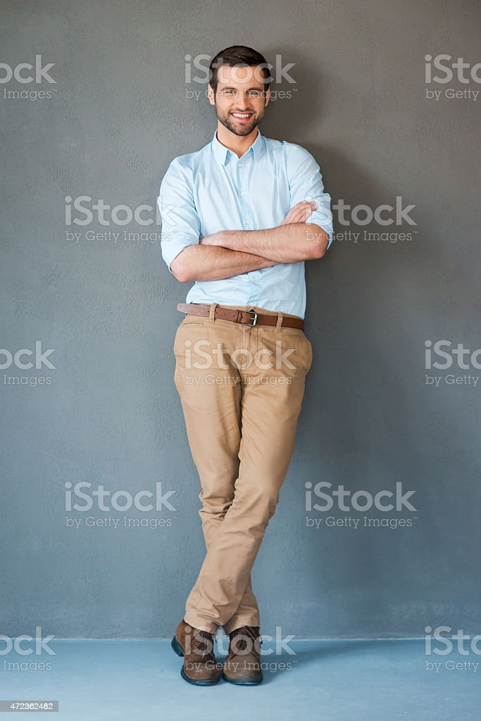 Smiling man with arms crossed facing the camera stock photo