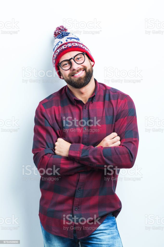 Smiling man with arms crossed Portrait of smiling caucasian man standing with his arms crossed on white background Adult Stock Photo