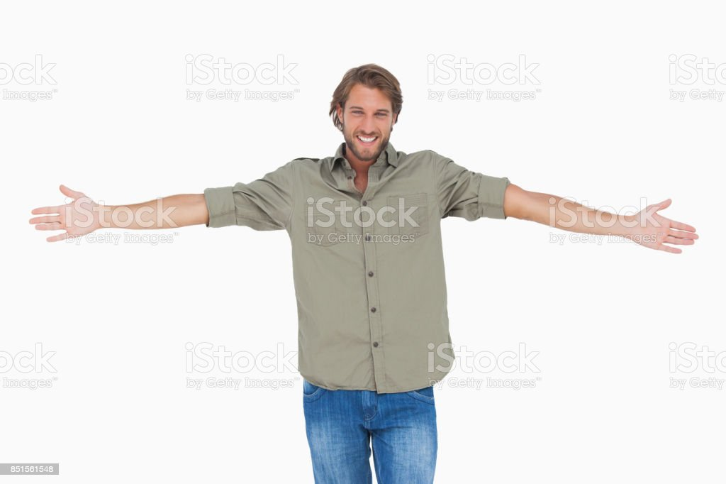 Smiling man with arms open wide stock photo