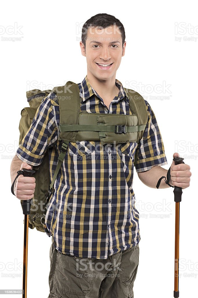 Smiling man with backpack and hiking poles royalty-free stock photo