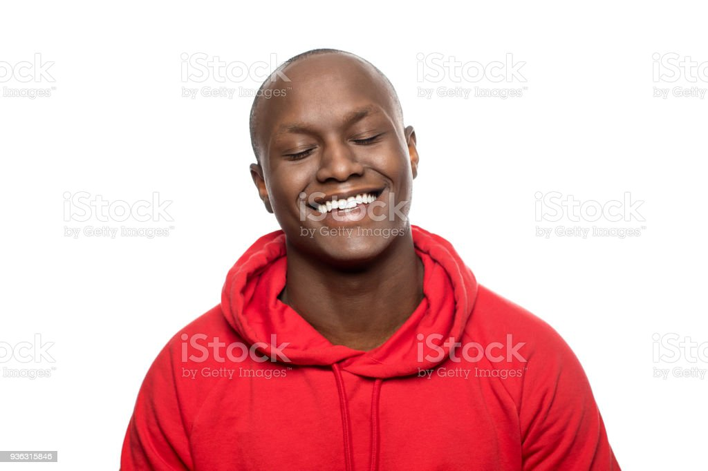 Smiling man with closed eyes and shaved head stock photo
