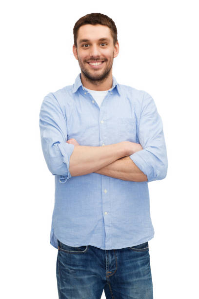 smiling man with crossed arms stock photo