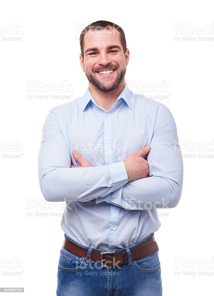Smiling man with crossed arms royalty-free stock photo
