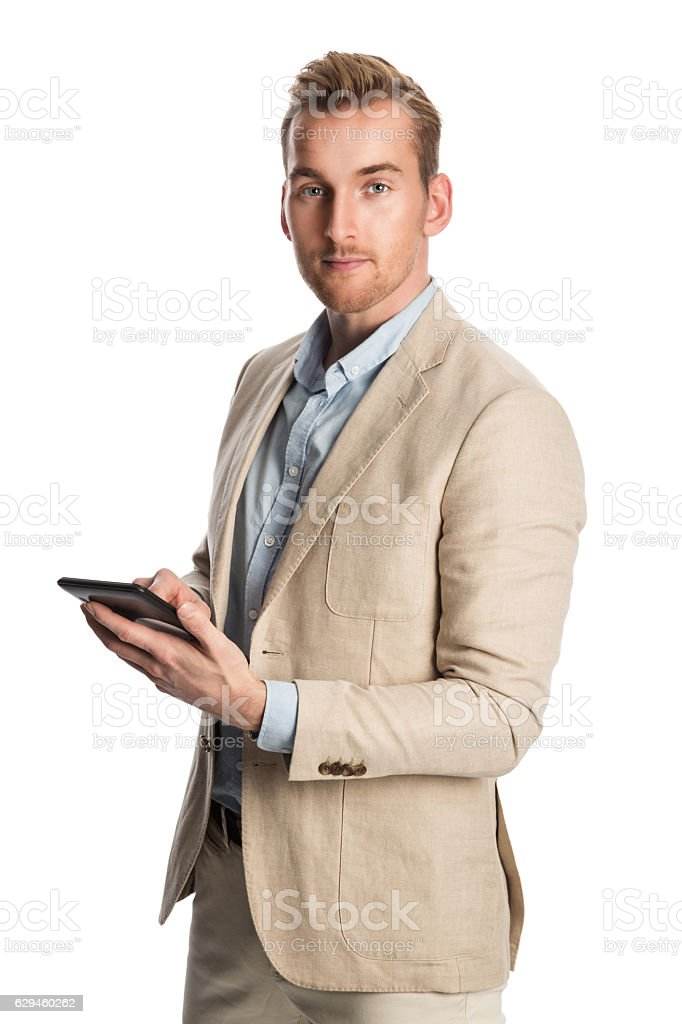 Smiling man with digital reader looking stock photo