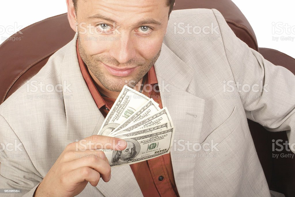 smiling man with few houndred dollars bills in the hand royalty-free stock photo