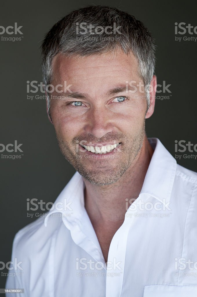 smiling man with grey hair royalty-free stock photo