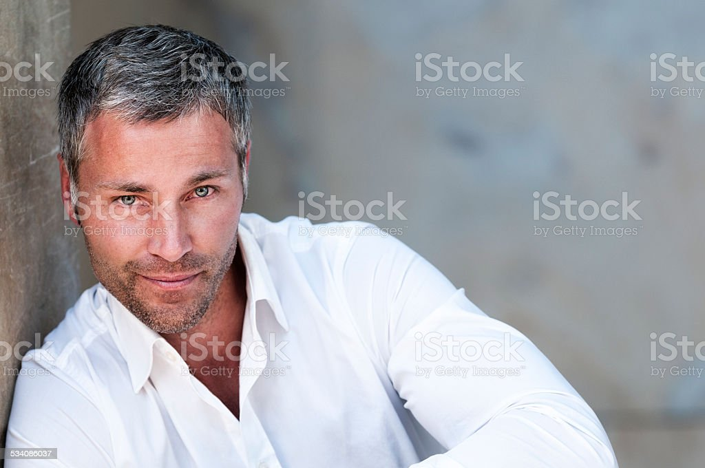 smiling man with grey hair stock photo