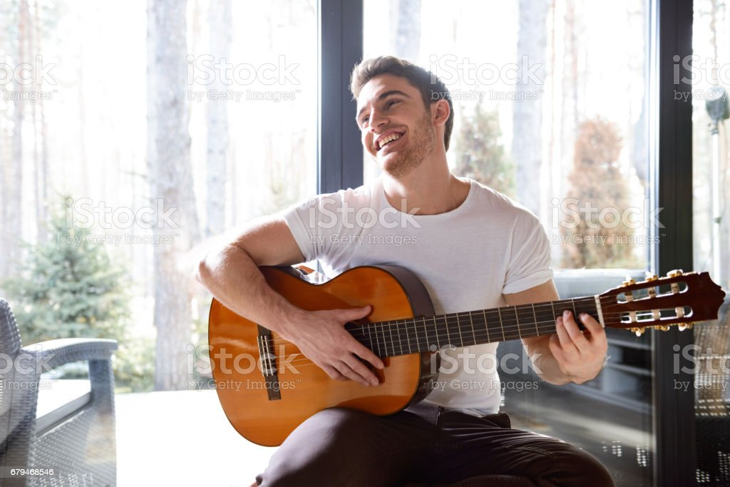 smiling man with guitar stock photo