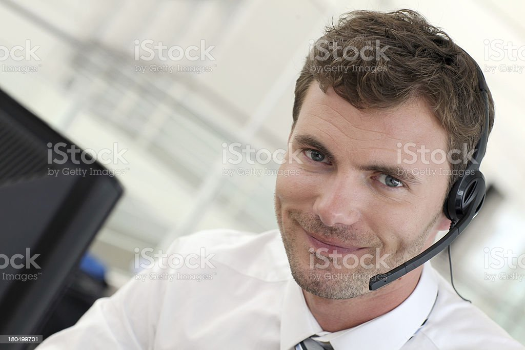Smiling man with haedset stock photo