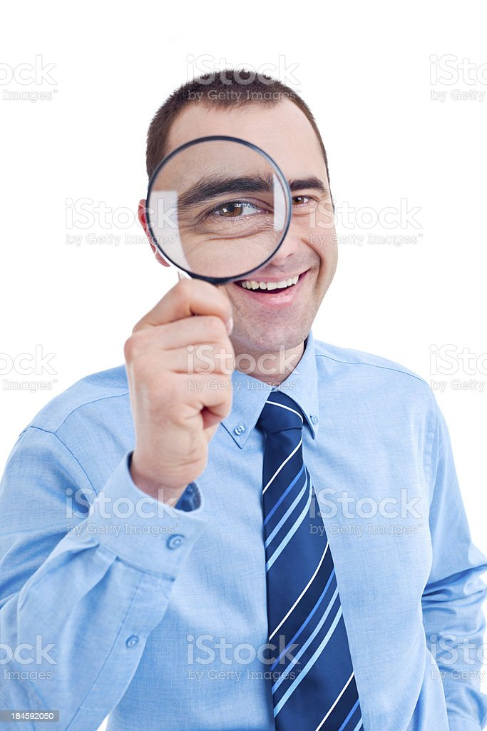 Smiling man with magnifying glass royalty-free stock photo