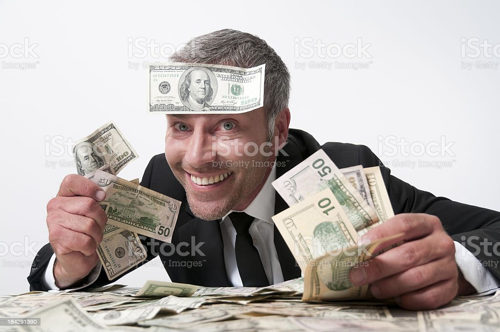 smiling man with many dollars stock photo