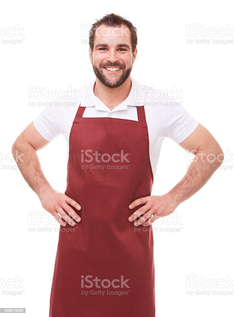 Smiling man with red apron stock photo