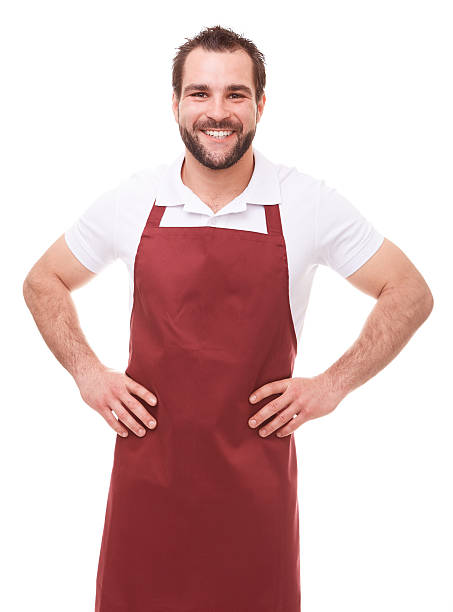 smiling man with red apron - apron stock pictures, royalty-free photos & images