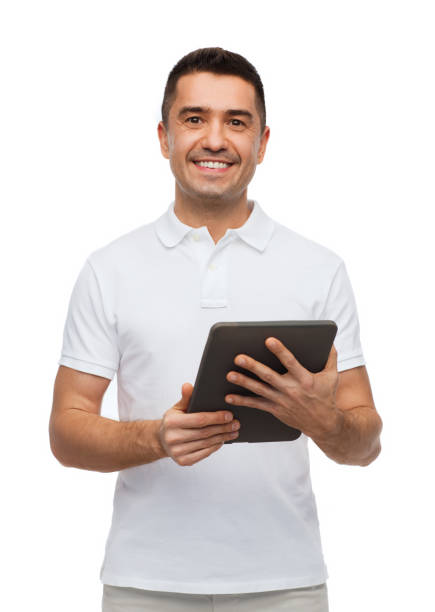 smiling man with tablet pc computer stock photo