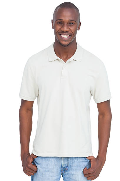 Smiling man with thumbs in pocket stock photo