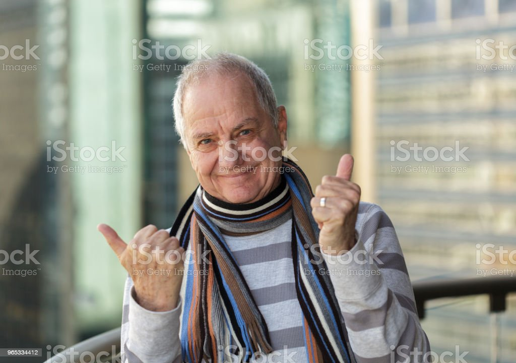 Smiling man with thumbs up. royalty-free stock photo