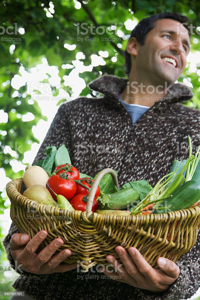 Smiling Man With Vegetable Basket stock photo