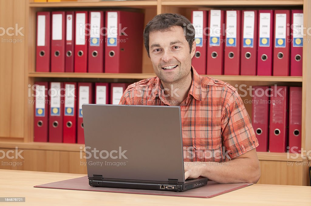 smiling man working at office royalty-free stock photo