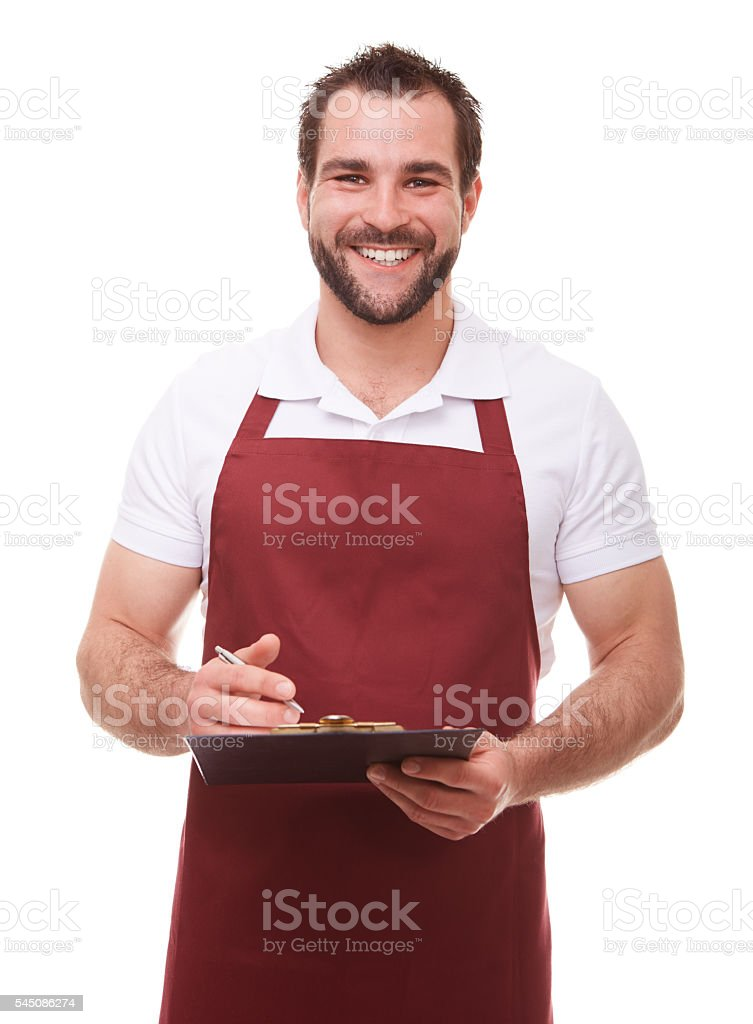 Smiling man writes on a black clipboard stock photo