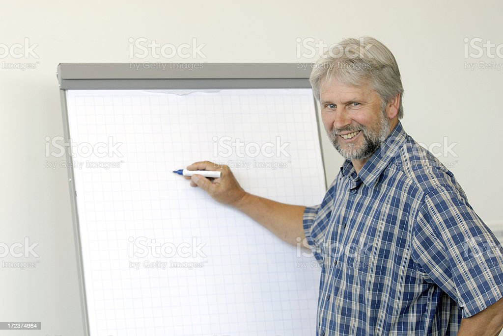 smiling man writing on clipboard royalty-free stock photo