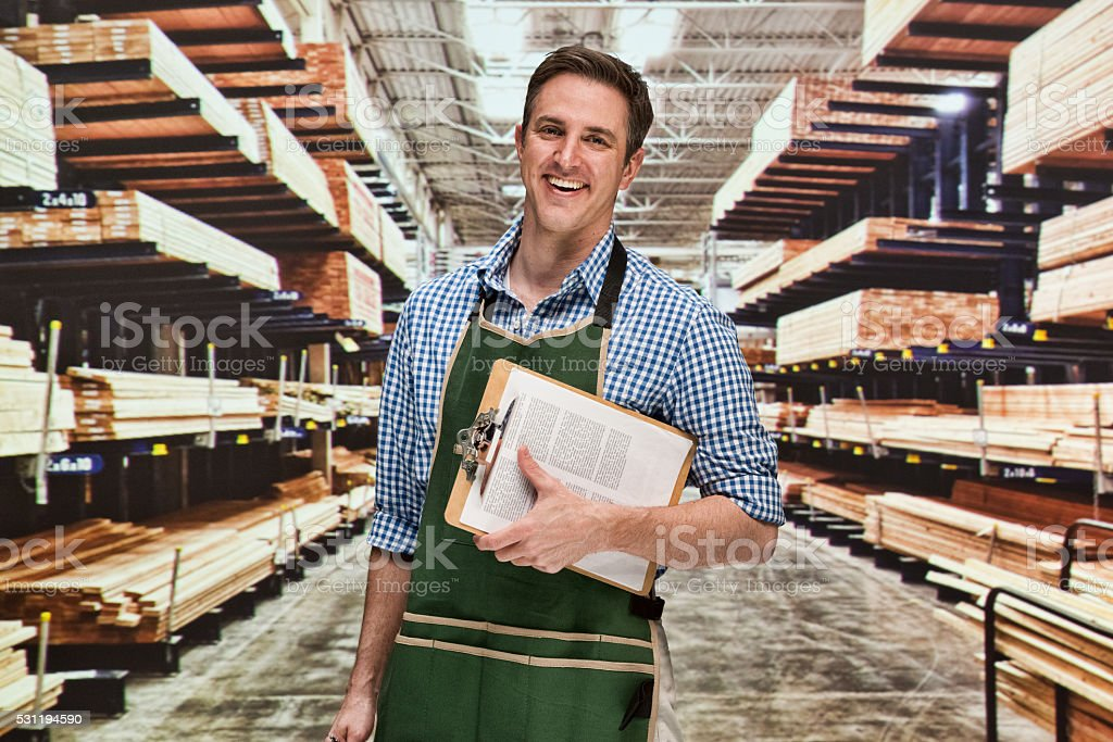 Smiling manager in warehouse stock photo
