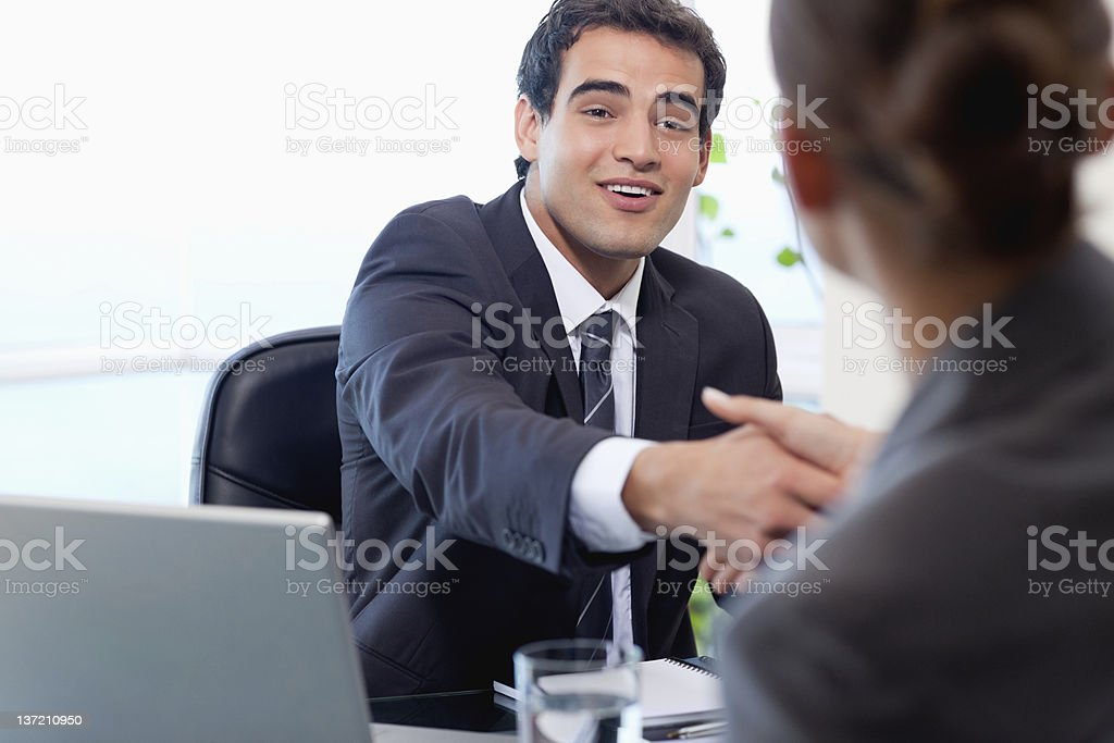 Smiling manager interviewing a female applicant royalty-free stock photo