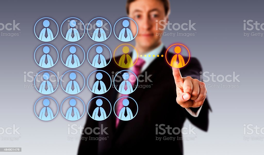 Smiling Manager Outsourcing To A Male Worker stock photo