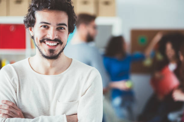 Smiling man's portrait in the office stock photo
