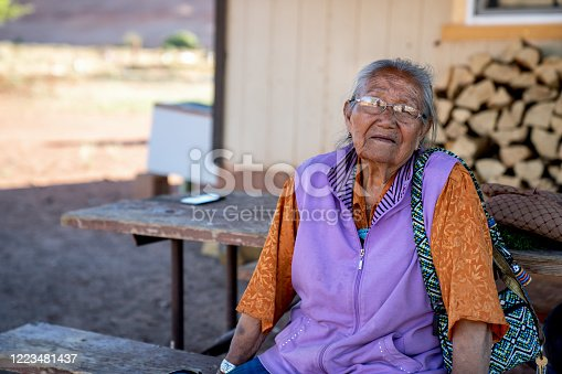 An elderly Navajo grandmother and Matriarch at her home, smiling sweetly