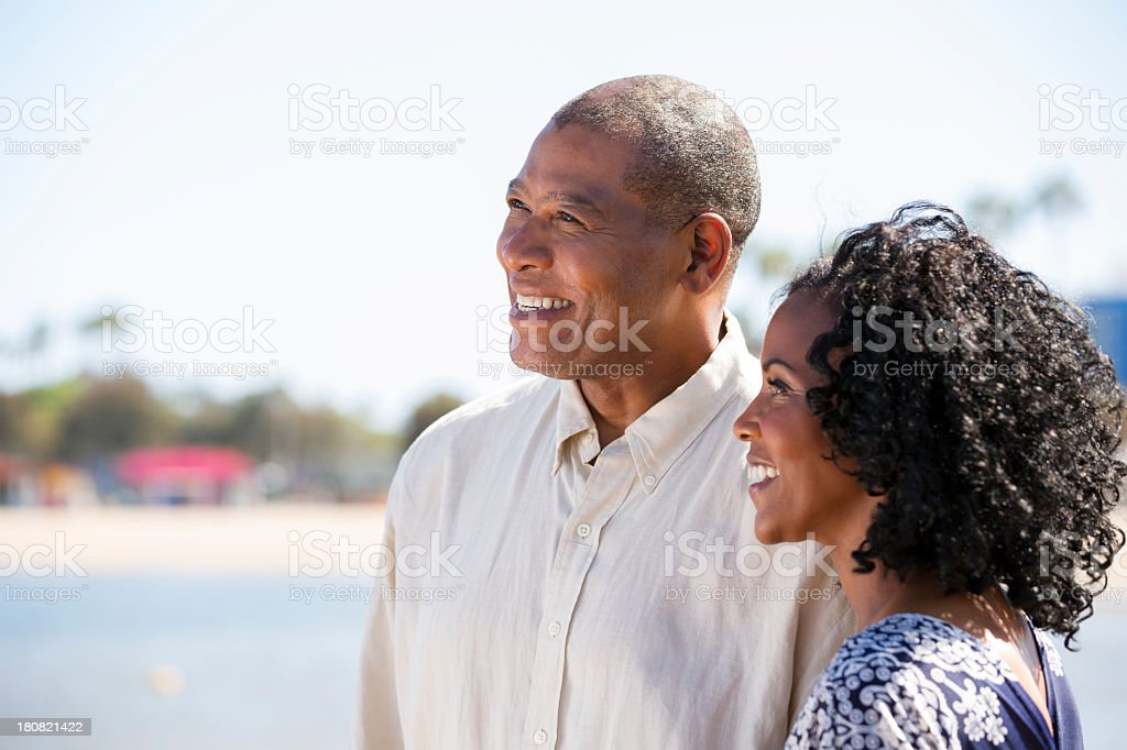 Smiling mature african american couple looking away stock photo
