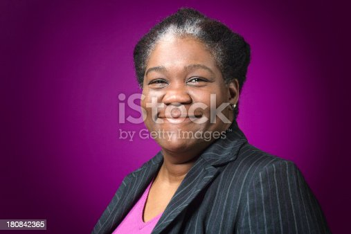 istock Smiling mature African American Lady 180842365