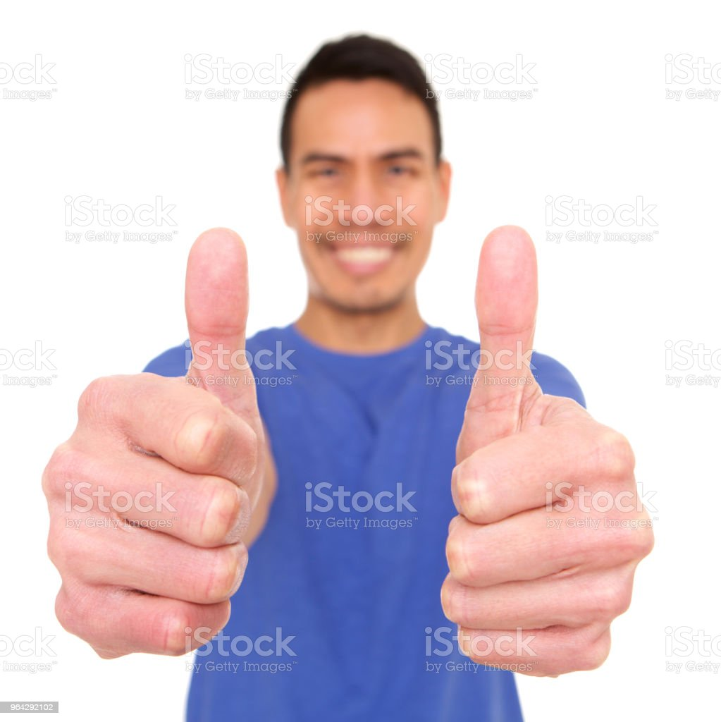 Smiling mature asian man giving thumbs up royalty-free stock photo