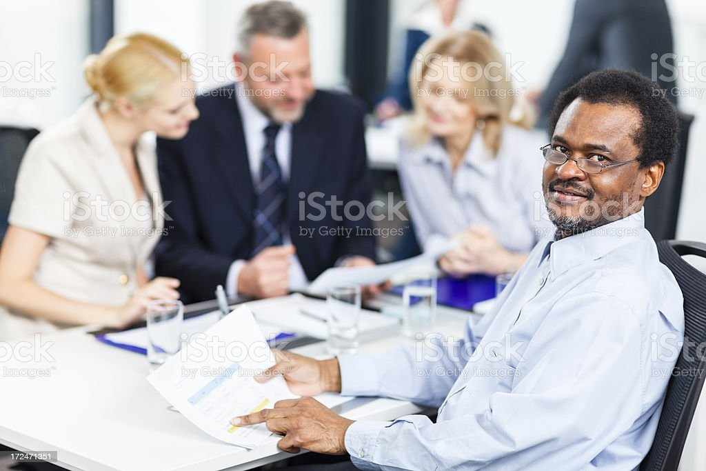 Smiling mature businessman at meeting royalty-free stock photo