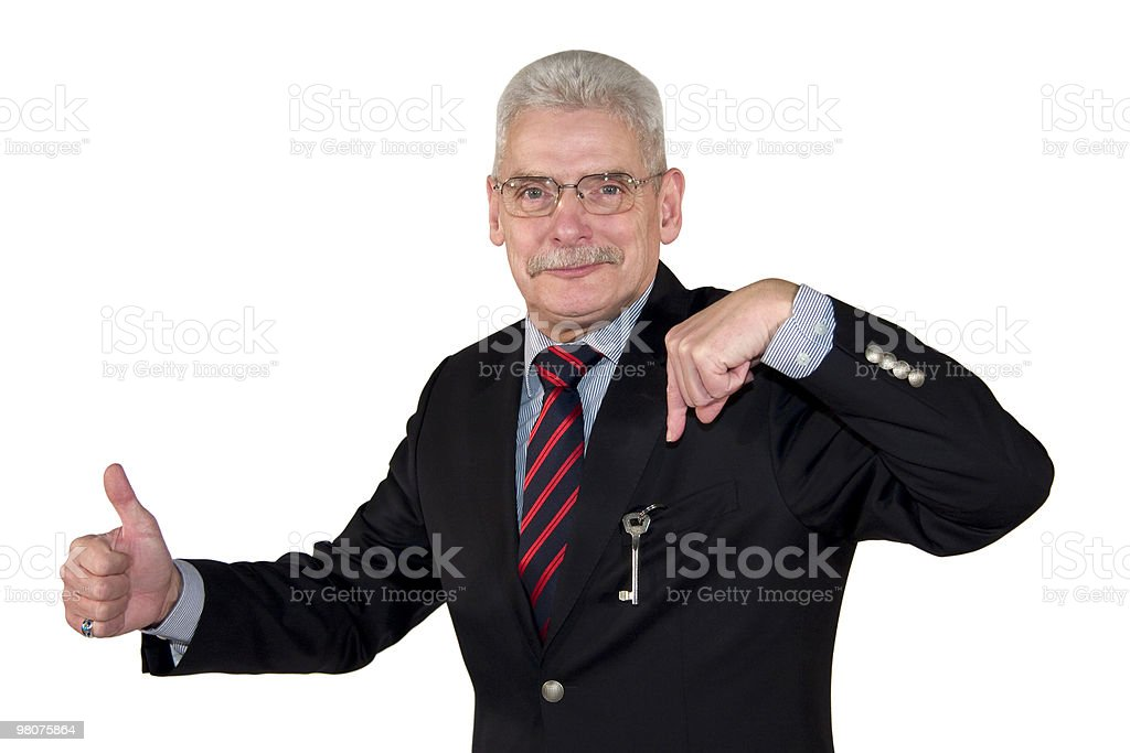 smiling mature businessman posing thumbs up royalty-free stock photo