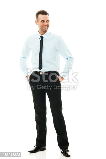 istock Smiling mature businessman standing 163218328