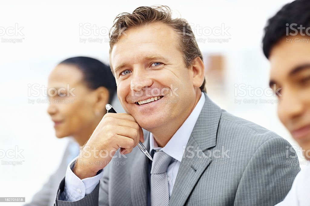 Smiling mature businessman with his colleagues royalty-free stock photo