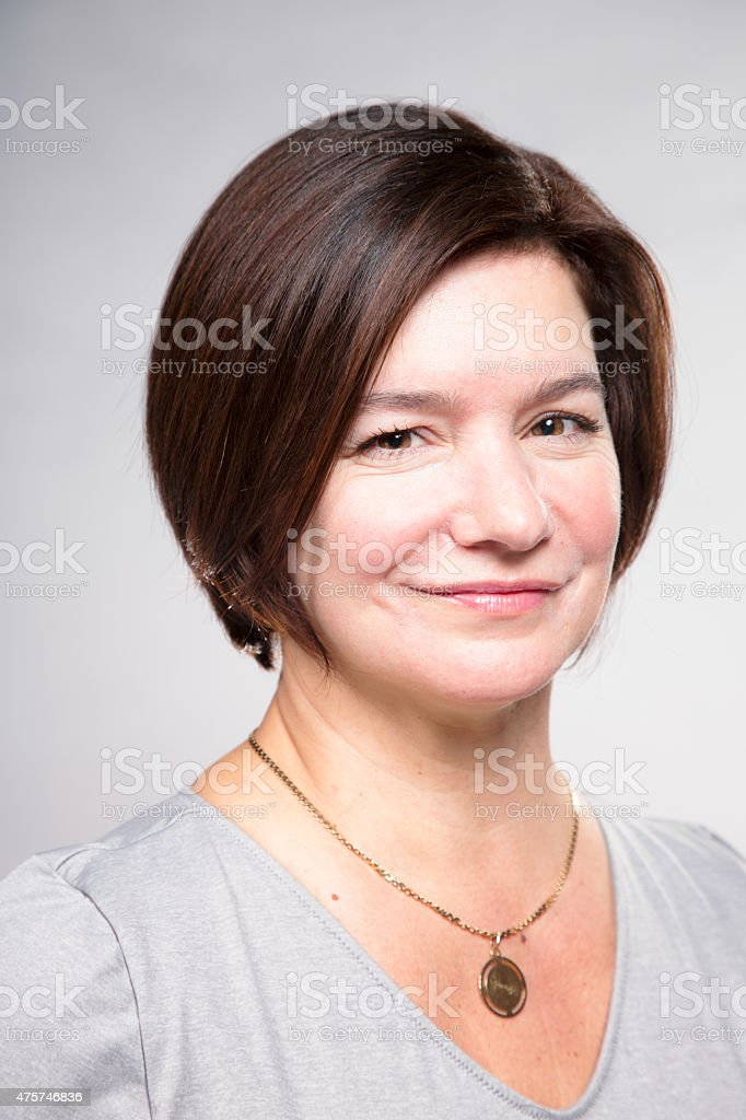 Smiling mature Caucasian mother close-up portrait smiling stock photo