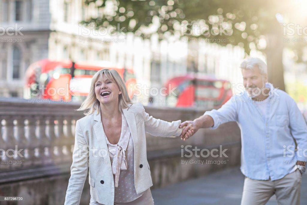 Smiling mature couple having fun in London stock photo
