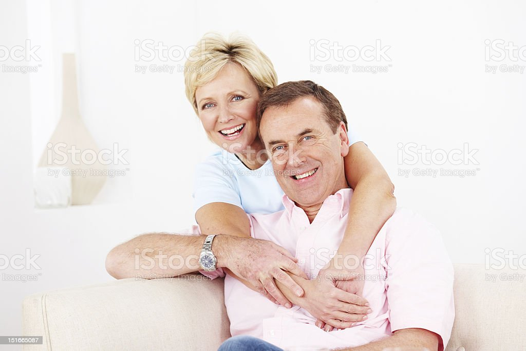 Smiling mature couple relaxing at home stock photo