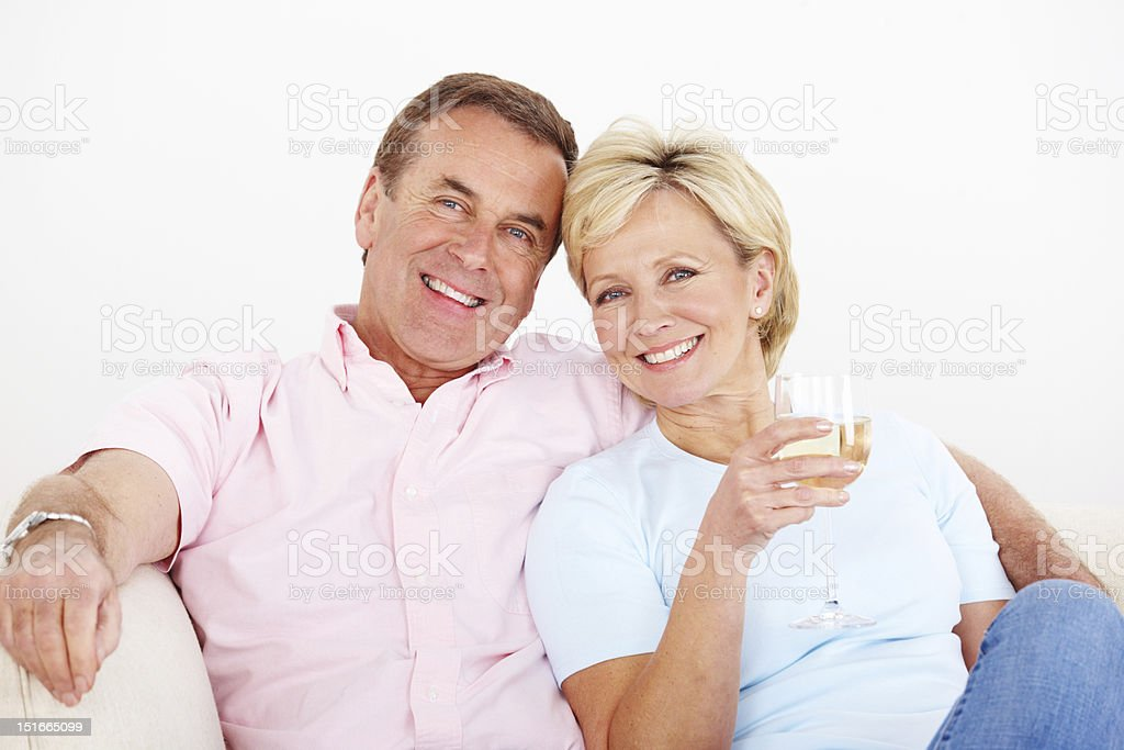Smiling mature couple relaxing at home royalty-free stock photo