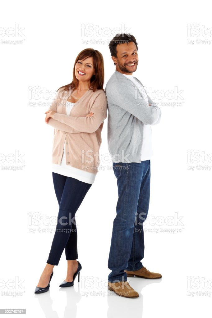 Smiling mature couple standing on white stock photo