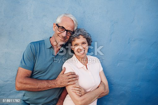 istock Smiling mature couple standing together 518911782