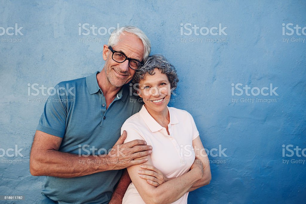 Smiling mature couple standing together stock photo